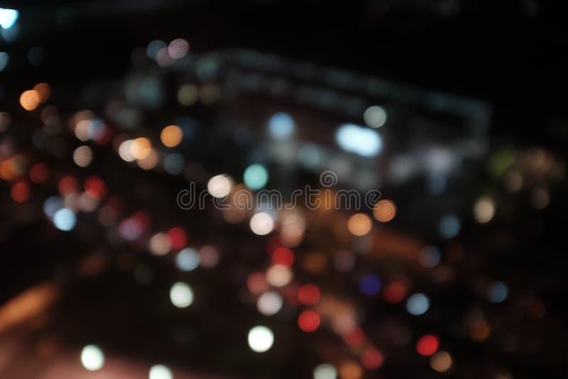 Nuit légère au fond d'abrégé sur tache floue de bokeh de ville photographie stock