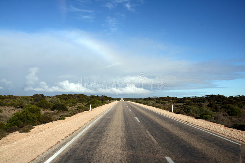 Nullarbor Plain Highway, Australia. The famous Nullarbor plain Highway, in Australia, and its famous longest straight line road royalty free stock photo