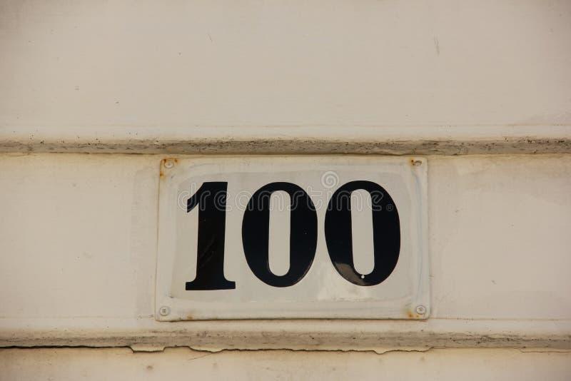 Numéro de maison 100 image libre de droits