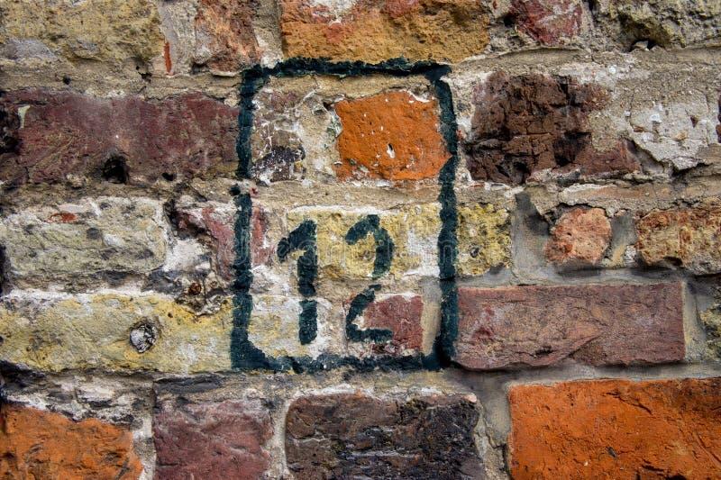 Numéro de maison douze 12 photographie stock