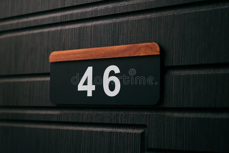 Numéro de maison quarante-six photographie stock