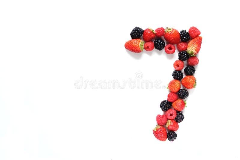 Numéro sept avec des fruits images libres de droits