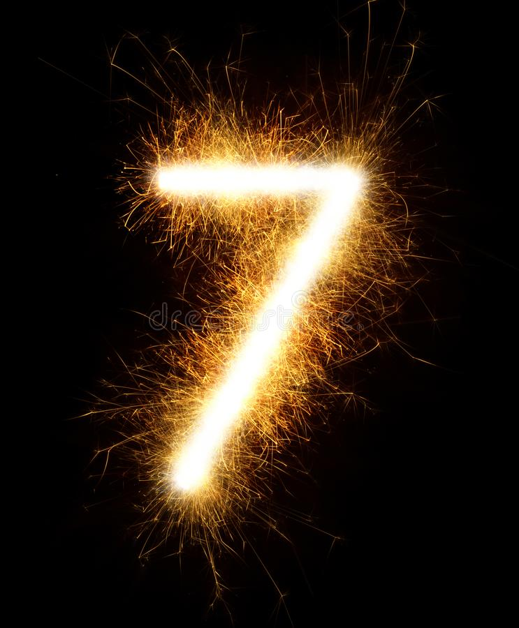 Free Number 7 Drawn With Spaklers On A Black Background Stock Image - 136431121