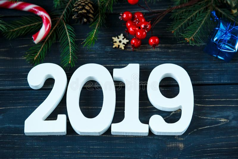 2019, branches of fir tree, decor on grey wooden table. New Year Goals list, things to do on Christmas royalty free stock photography