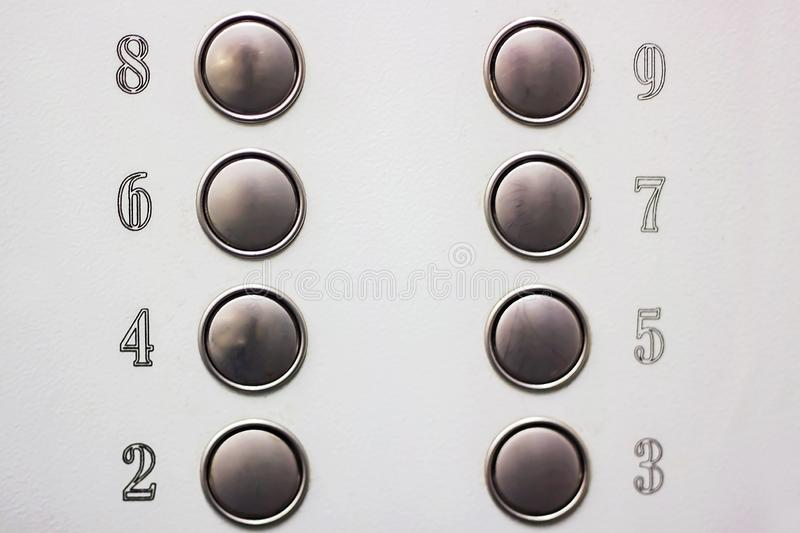Number buttons in the Elevator on grey background royalty free stock images