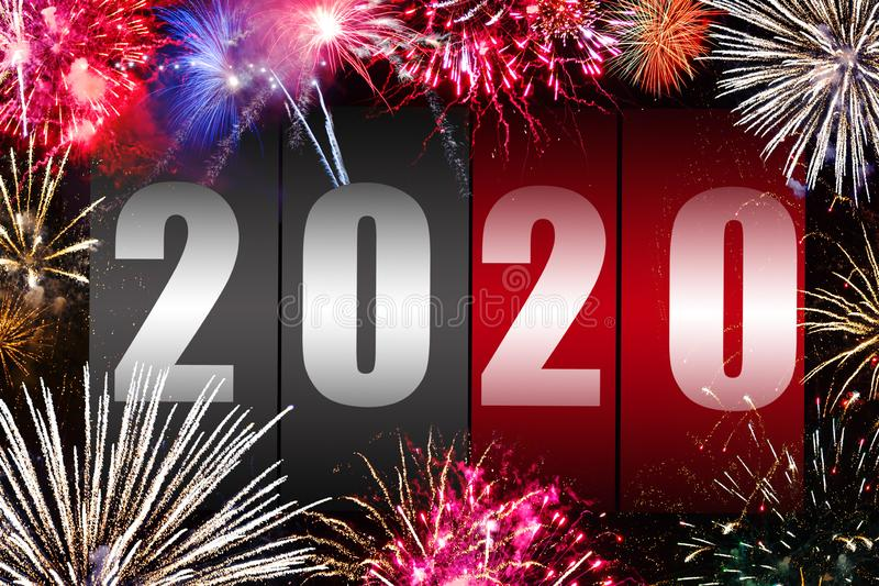 Number 2020 on the counter with fireworks. Happy new year concept royalty free stock images