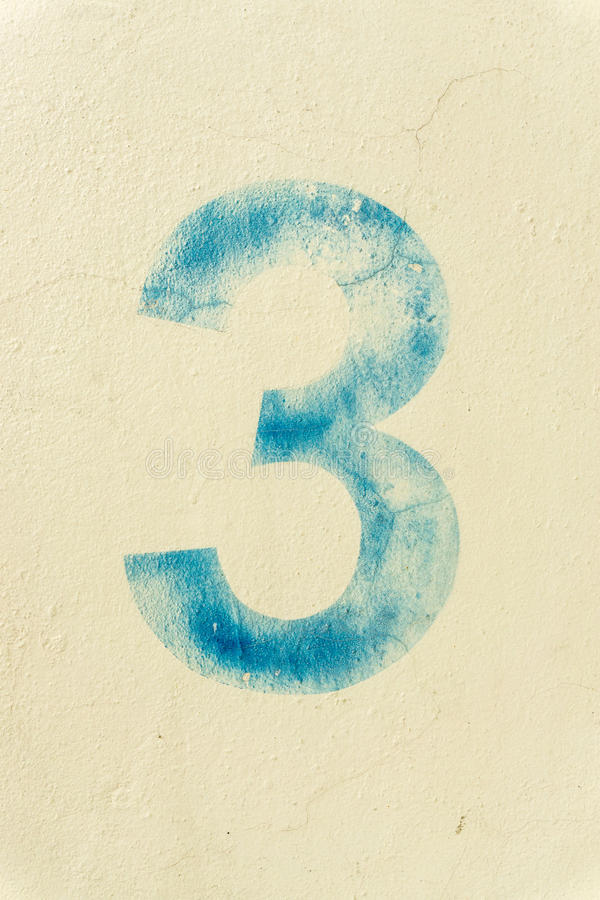 The number 3 on the dirty wall royalty free stock photography