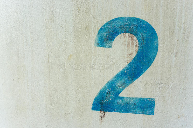 The number 2 on the dirty white wall royalty free stock images