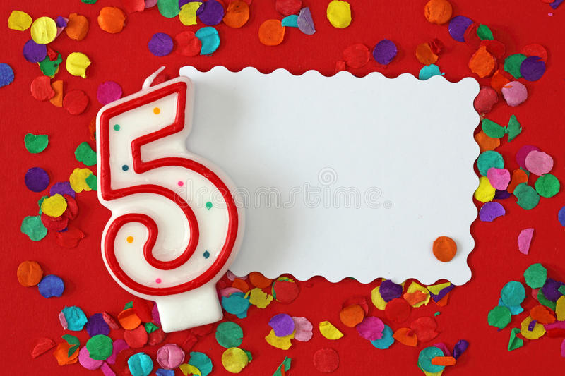 Number five birthday candle. On red background royalty free stock images