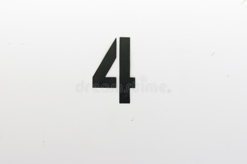 number four stenciled on wall in stairwell royalty free stock image