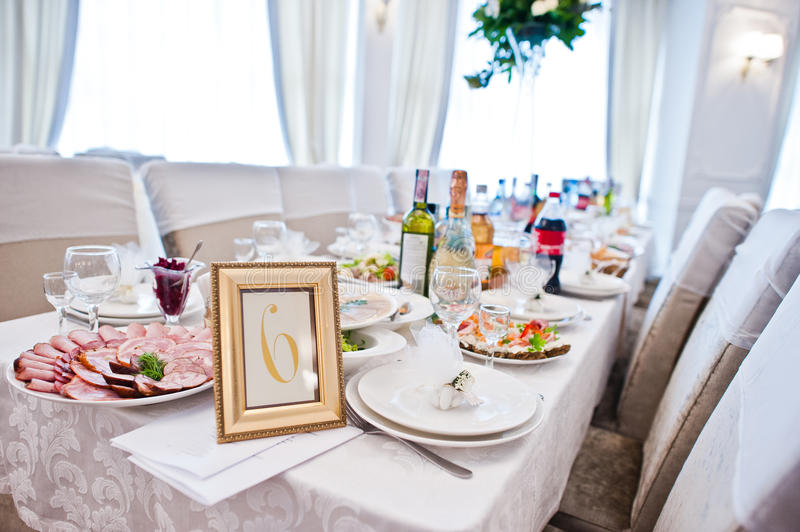 Number 6 in the frame at guest table on wedding reception.  royalty free stock image