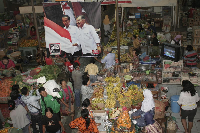 A number of Gede Market Traders Celebrate Victory. Election of the President of Indonesia Joko Widodo be Gede Market traders make do with kissing excitement Joko stock photography