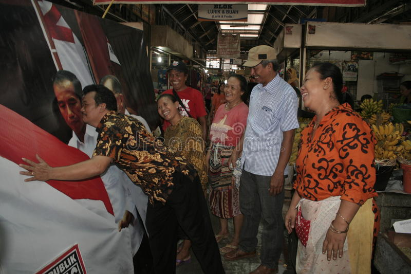 A number of Gede Market Traders Celebrate Victory. Election of the President of Indonesia Joko Widodo be Gede Market traders make do with kissing excitement Joko royalty free stock images