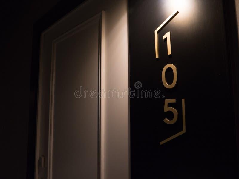 Number 105 in luxury hotel room door royalty free stock photo