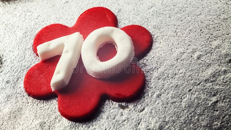 Number 70 Made of Fondant. Decoration of a 70 birthday cake made of fondant stock photography
