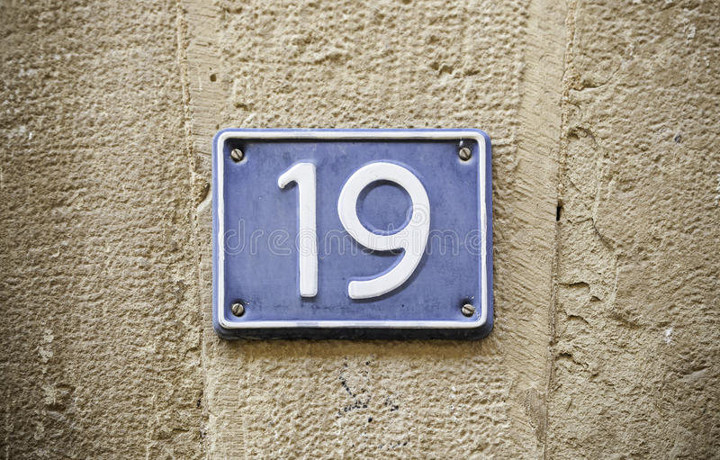 Number nineteen in the wall stock photography