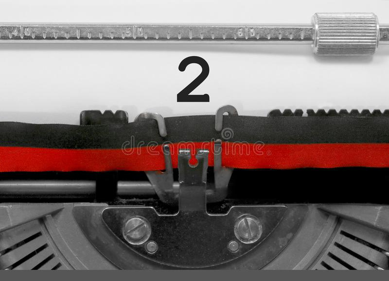 2 Number by the old typewriter on white paper stock photo