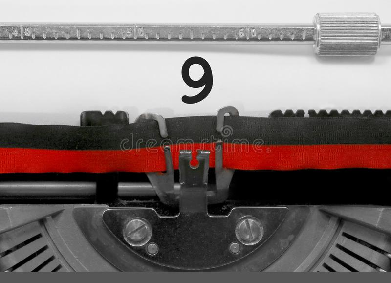 9 Number by the old typewriter on white paper stock photos