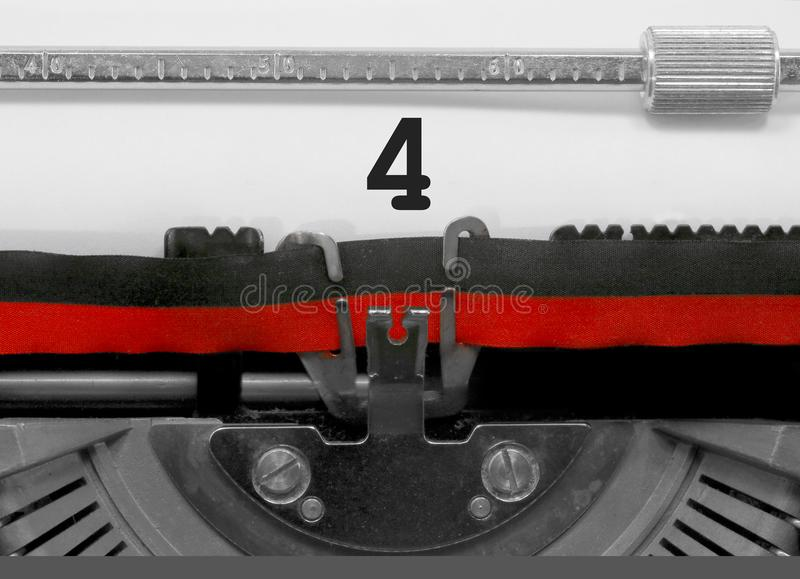 4 Number by the old typewriter on white paper royalty free stock photos