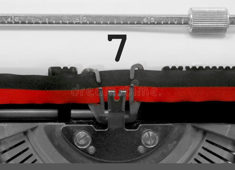 7 Number by the old typewriter on white paper stock photos