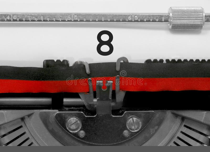 8 Number by the old typewriter on white paper royalty free stock photo