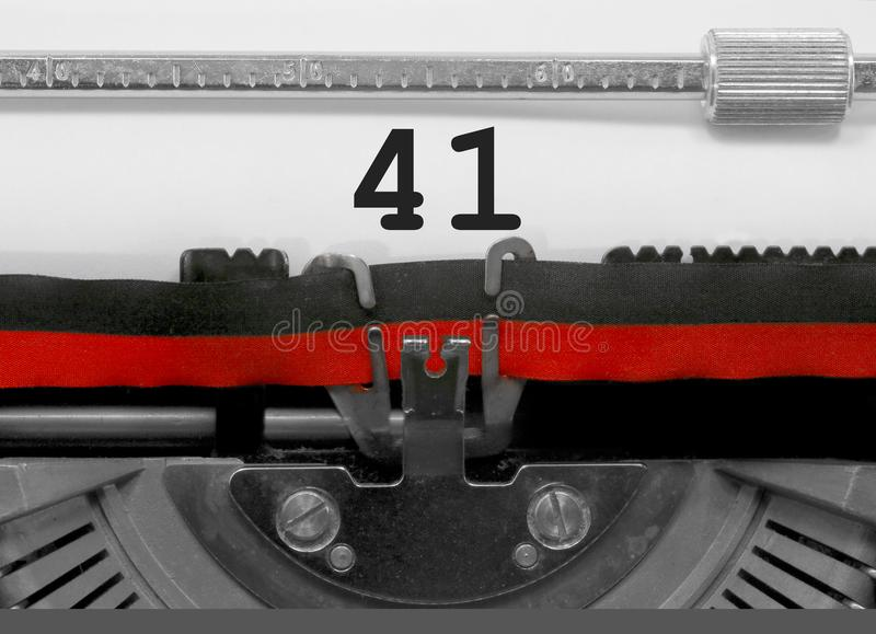 41 Number by the old typewriter on white paper royalty free stock photos