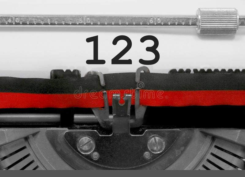 123 Number by the old typewriter on white paper stock images