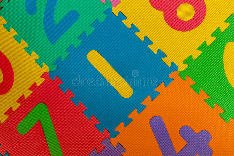 Number one. Colourful digits on the child's learning mat stock image