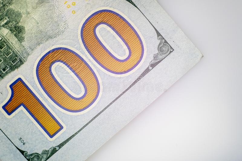 The number one hundred. Close-up of a part of the US hundred dollar bill. Macro stock image