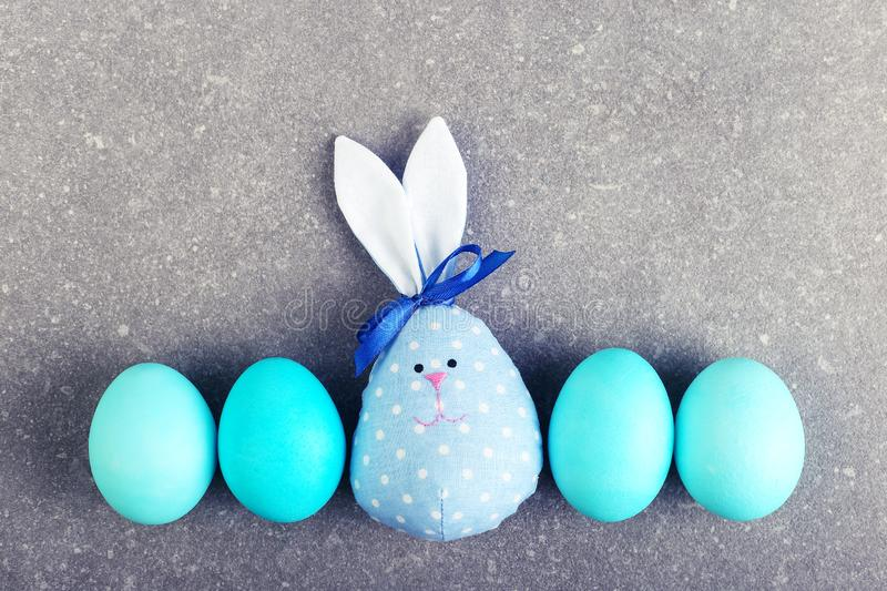 A number of painted eggs, including two handmade Easter bunny, blue and pink stock photography