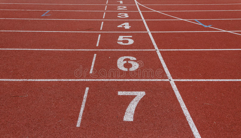 Number of running track. Numbered lanes on athletic running track with lane one in foreground stock photos