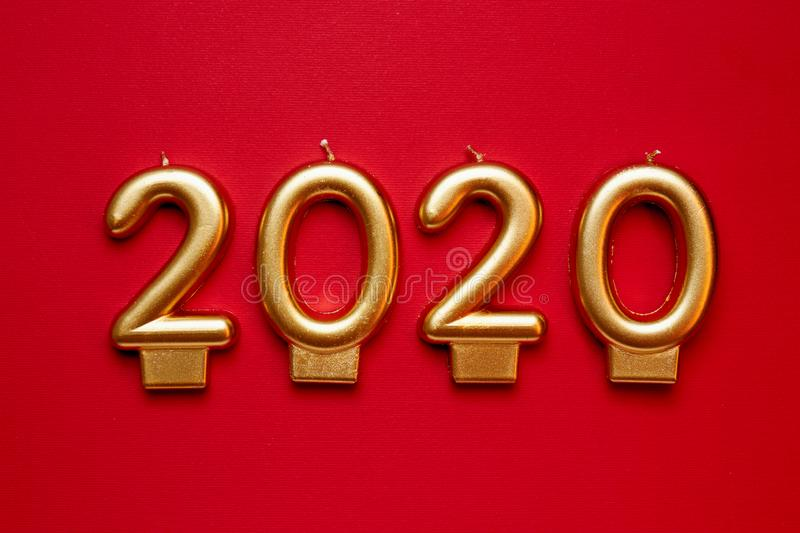 Number-shaped candles forming golden numbers for 2020 New Year royalty free stock photo