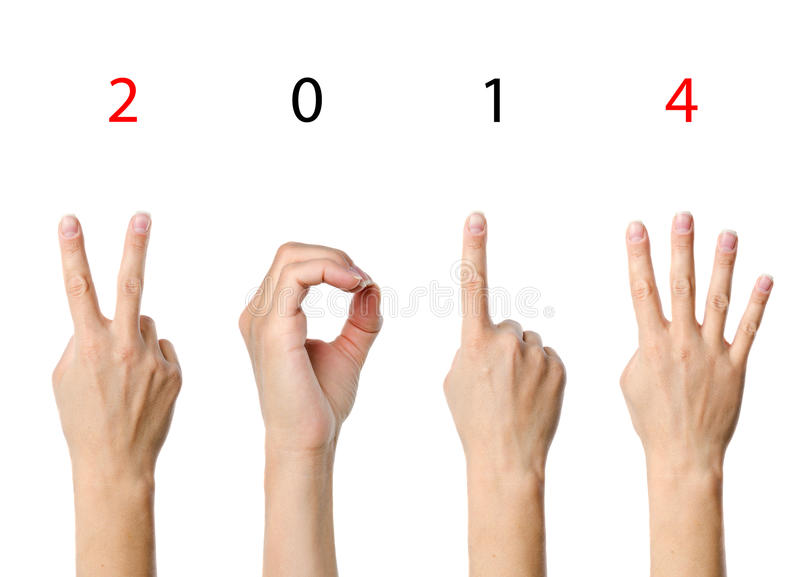 The number 2014. Shown by fingers in creative New Year greeting card royalty free stock photos