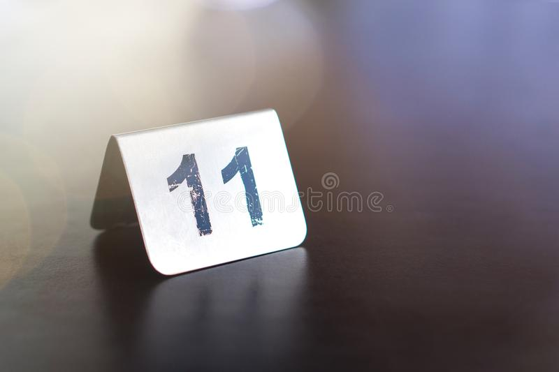 Number sign on restaurant table to show reservation. royalty free stock image