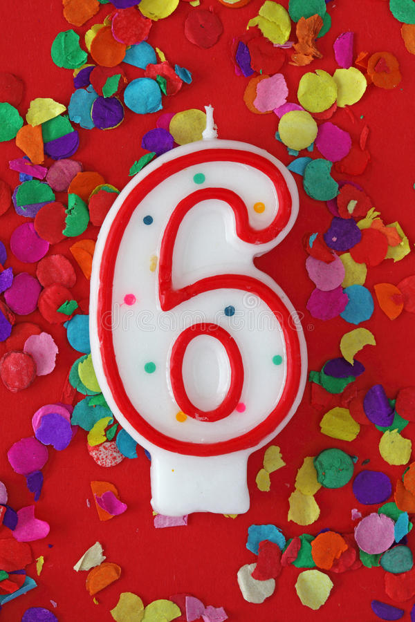Number six birthday candle. On red background royalty free stock photos