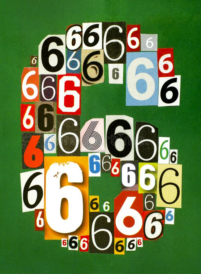 Number Six made from numbers cutting from magazines on green background stock image