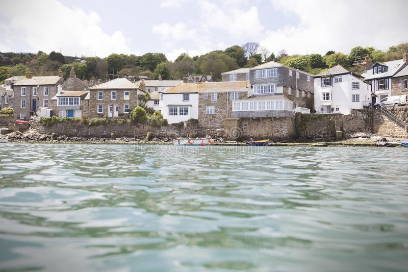 Cottages overlooking Mousehole Harbour in summer stock photography