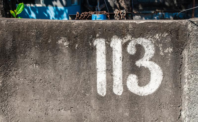 113 number on a stree wall paint in white royalty free stock images