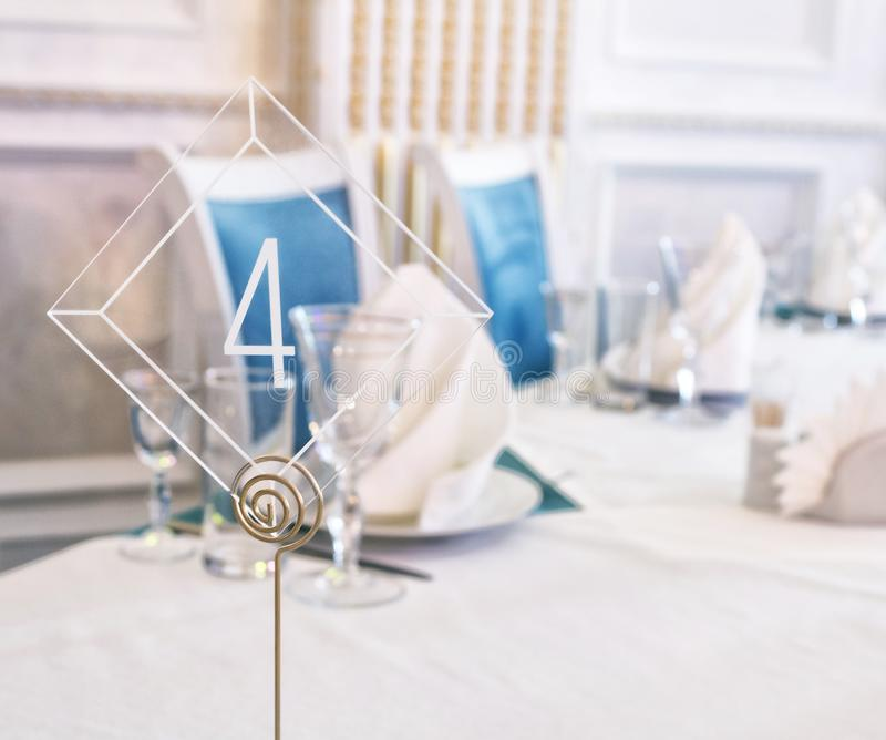 Number on a table for guests in restaurant. Wedding decor. stock photo