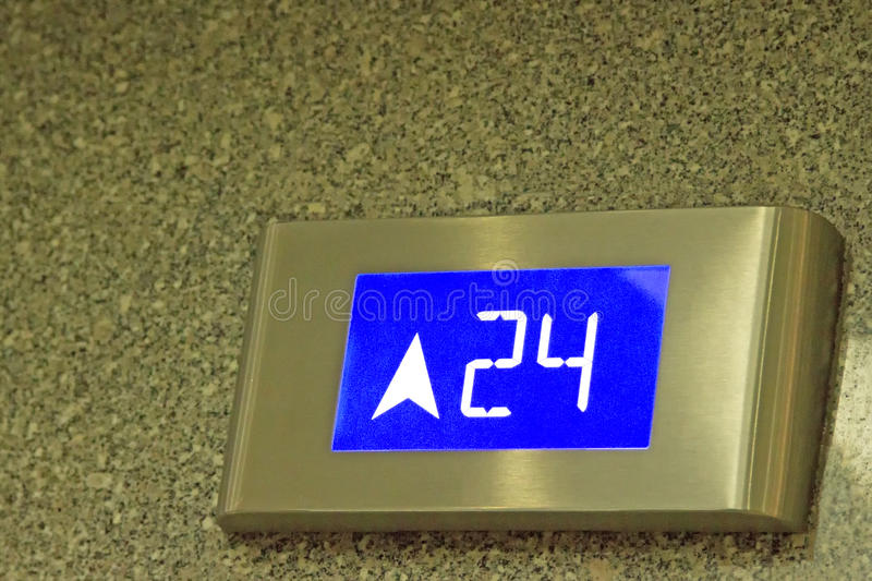 The number tells the 24th floor of the elevator. In under ligthing royalty free stock photo
