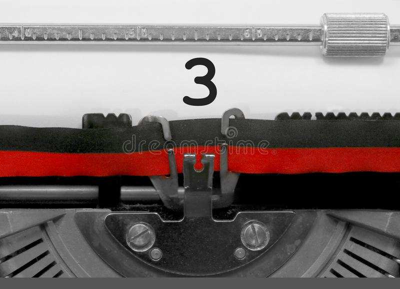 3 Number by the old typewriter on white paper stock images