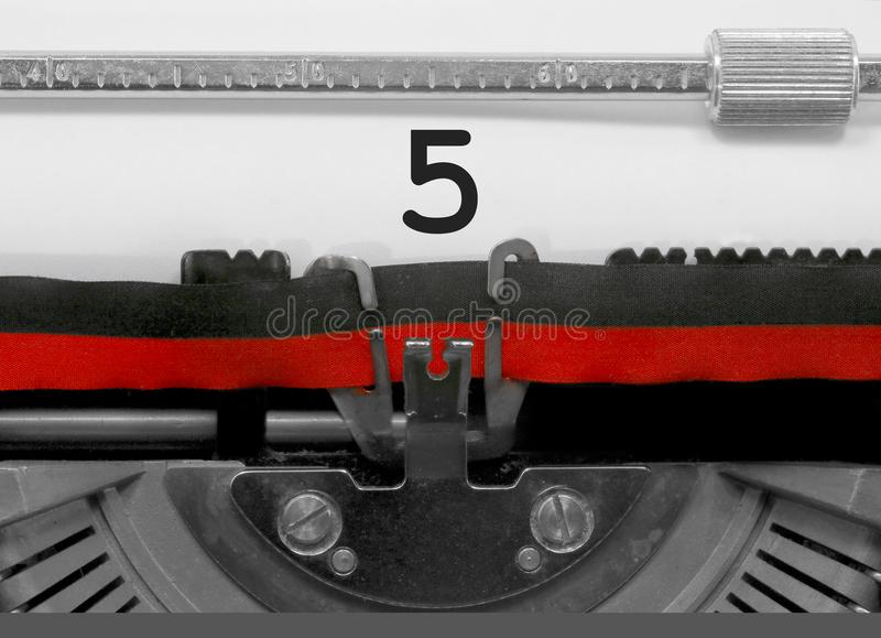 5 Number by the old typewriter on white paper stock photography