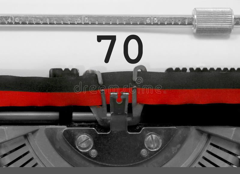 70 Number by the old typewriter on white paper royalty free stock images