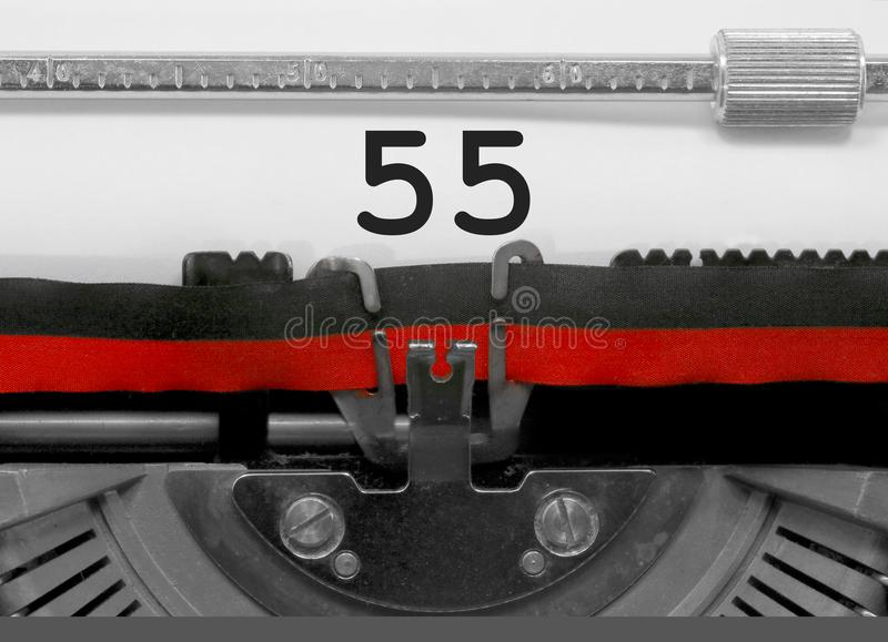 55 Number by the old typewriter on white paper royalty free stock image