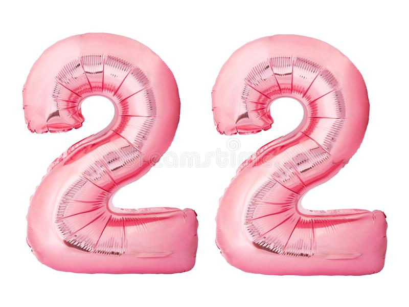 Number 22 twenty two made of rose gold inflatable balloons isolated on white background stock photo