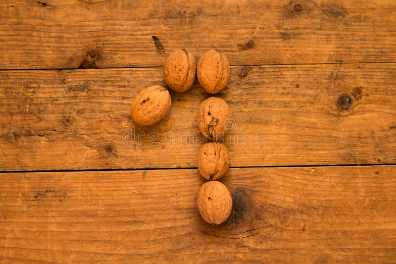 Number 1 from walnuts. Top view of english alphabet made from walnuts on a wooden table. Number 1 stock photography
