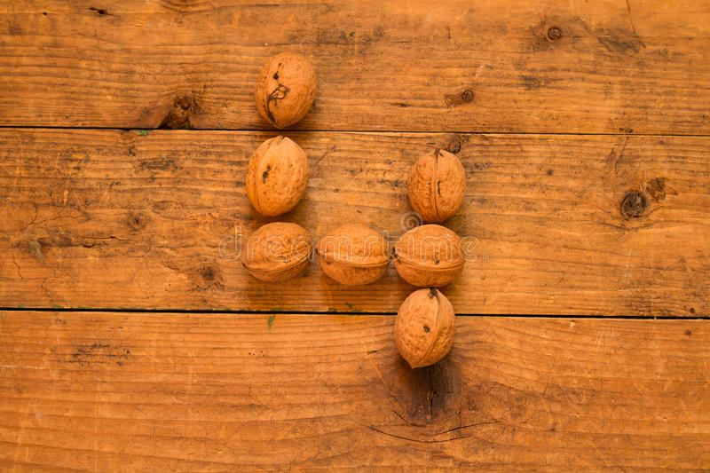 Number 4 from walnuts. Top view of english alphabet made from walnuts on a wooden table. Number 4 stock photography