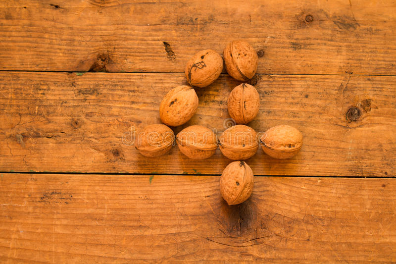 Number 4 from walnuts. Top view of english alphabet made from walnuts on a wooden table. Number 4 stock image