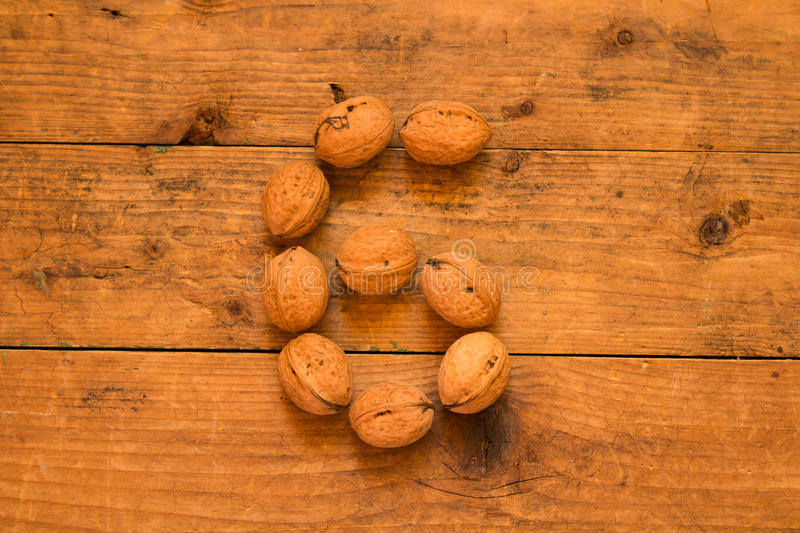 Number 6 from walnuts. Top view of english alphabet made from walnuts on a wooden table. Number 6 stock photo