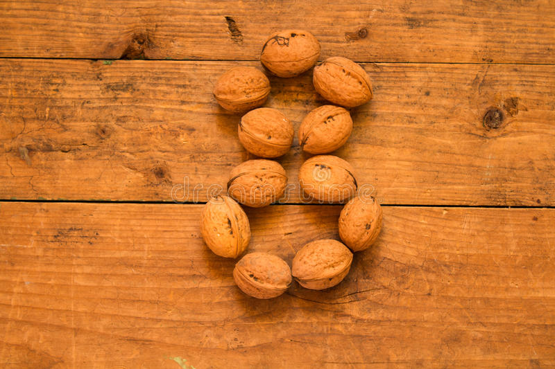 Number 8 from walnuts. Top view of english alphabet made from walnuts on a wooden table. Number 8 royalty free stock images